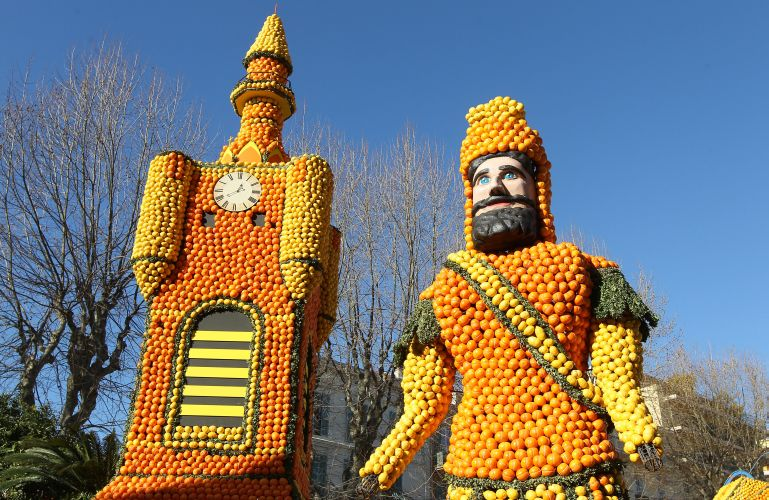 "A picture shows sculptures made with oranges and lemons representing a ""beffroi"" (Belfry) and a ""giant"" symbolising the Northern region of France on February 16, 2012 in Menton on the French Riviera, ahead of the start of the ""Fete du Citron"" (lemon carnival). The theme of this 79th edition, running from February 17 until March 07, 2012, is ""French regions"". AFP PHOTO / VALERY HACHE"